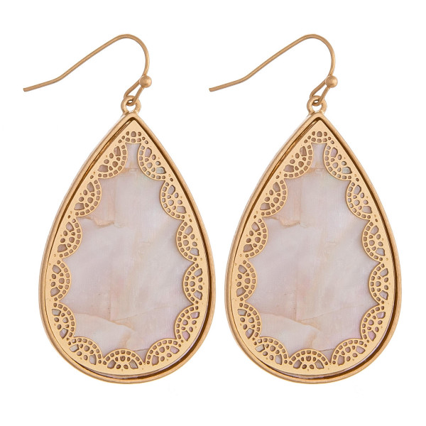 "Long metal teardrop earrings featuring mother of pearl inspired detail and gold accents. Approximately 1.5"" in length."