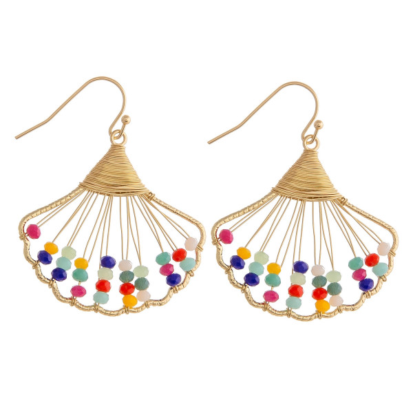 "Gold wire wrapped seashell earrings with multicolor beaded accents. Approximately 1"" in length."