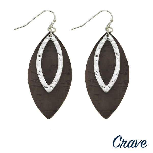 "Cork inspired earrings featuring a metal center accent. Approximately 2"" in length."
