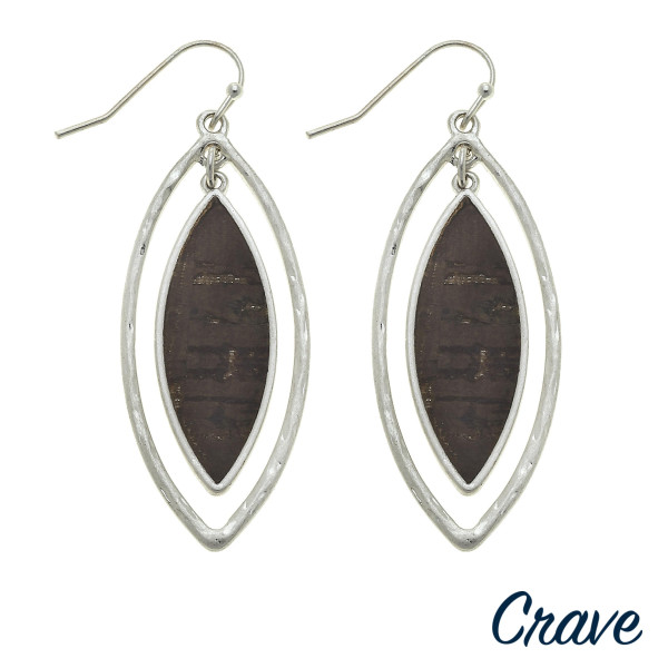"Double pointed oval earrings featuring a cork inspired center detail. Approximately 2"" in length."