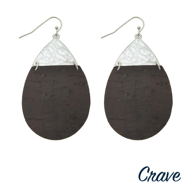 "Cork inspired teardrop earrings featuring a metal accent. Approximately 2"" in length."