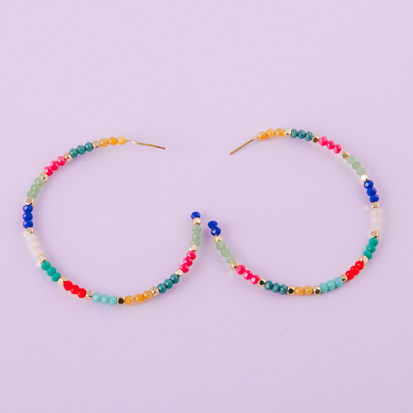 "Large open hoop earrings featuring multicolor faceted bead details and gold accents. Approximately 2.5"" in diameter."