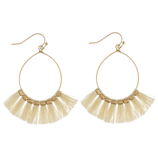 """Dainty teardrop earrings featuring tassel details with gold accents. Approximately 2"""" in length."""