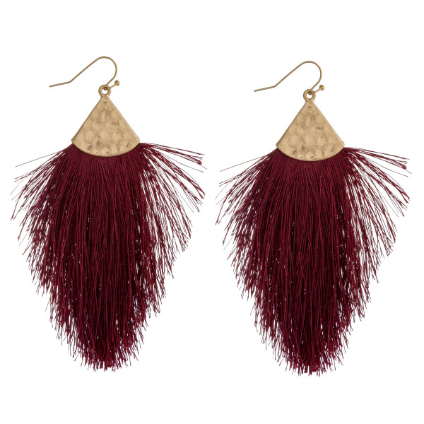 """Long drop earrings featuring tassel details and gold metal accents. Approximately 3.5"""" in length."""