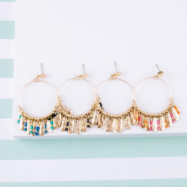 """Dainty circular earrings featuring beaded tassel details with gold metal accents. Approximately 2"""" in length."""