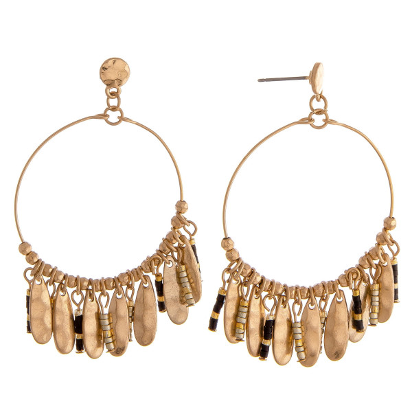 "Dainty circular earrings featuring beaded tassel details with gold metal accents. Approximately 2"" in length."