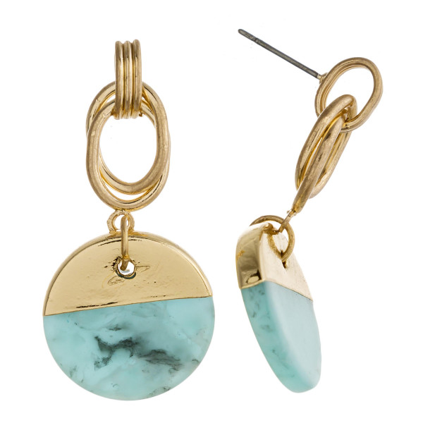 "Metal drop earrings featuring a natural stone inspired disc detail with gold accents. Approximately 2"" in length."