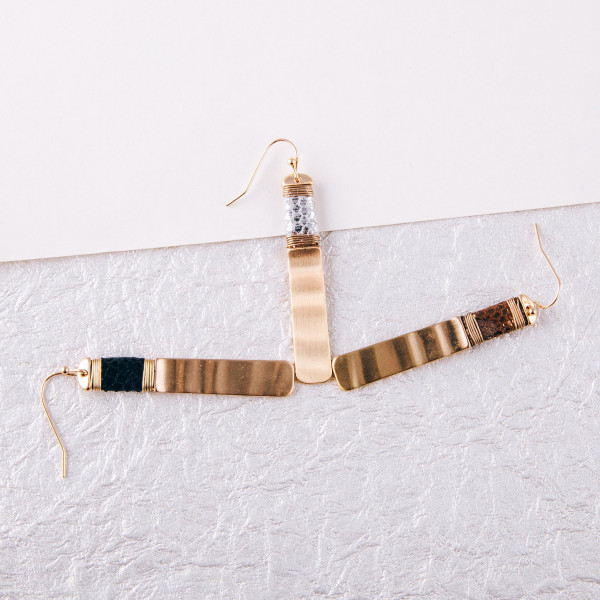 """Metal bar drop earrings featuring snakeskin and wire wrapped details. Approximately 2"""" in length."""