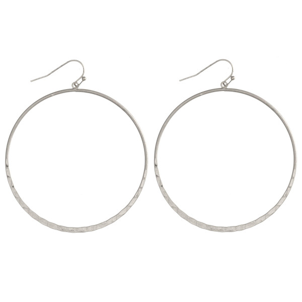 "Circular metal drop earrings featuring a hammered texture. Approximately 2.5"" in diameter. Approximately 3"" in length."