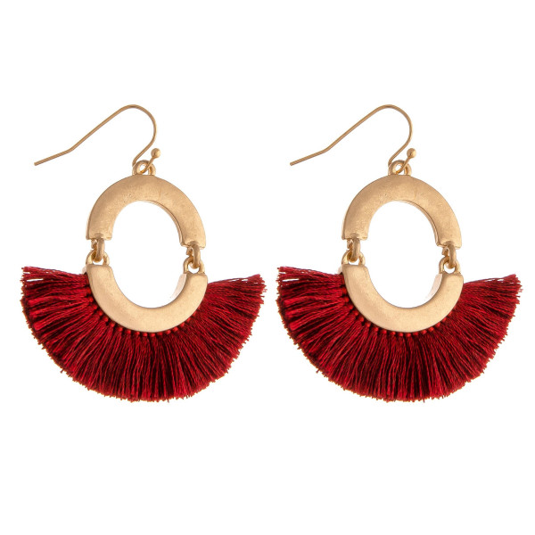 """Drop earrings featuring tassel details and gold metal accents. Approximately 2"""" in length."""