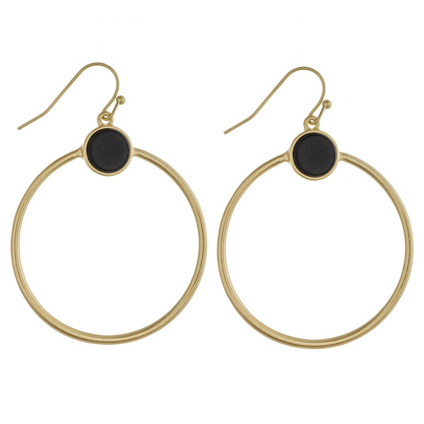 """Metal circular earrings featuring a natural stone accent. Approximately 2"""" in length."""