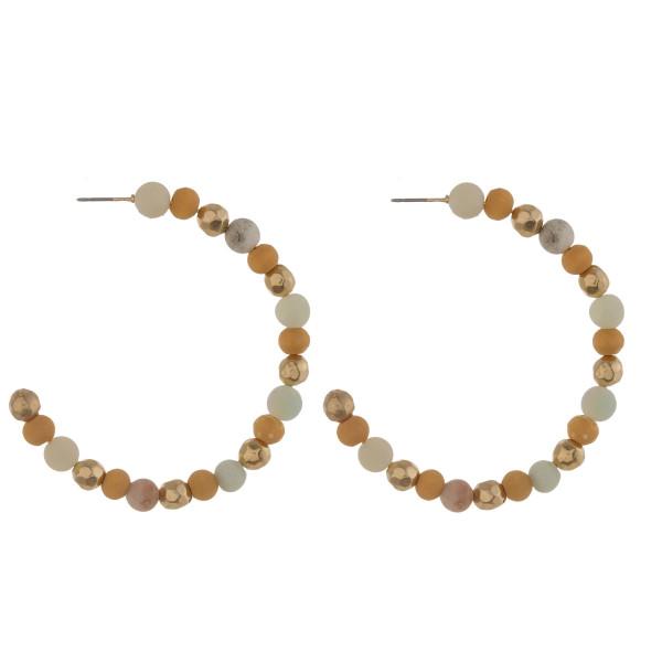 "Natural stone and wood beaded hoop earrings. Approximately 2.5"" in diameter."