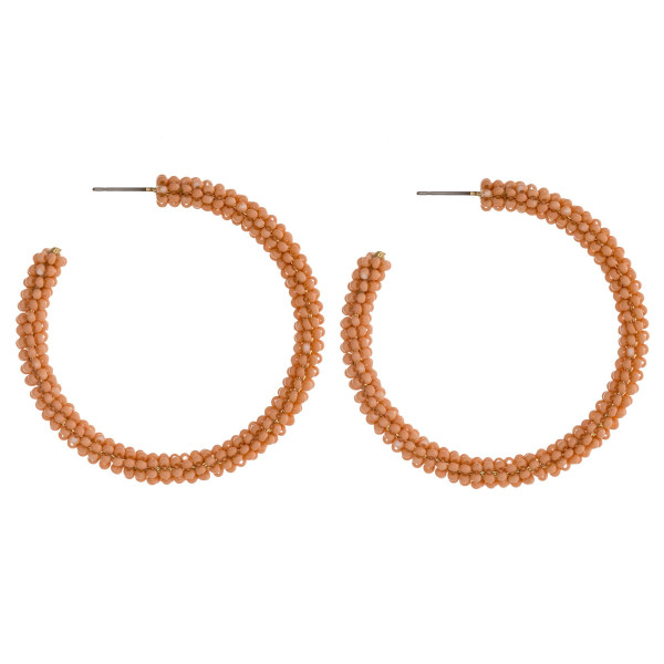 "Seed beaded open hoop earrings featuring a stud post. Approximately 2"" in diameter."