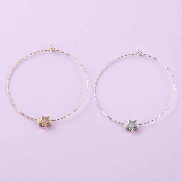 "Large dainty hoop earrings featuring a star accent. Approximately 2.5"" in diameter."