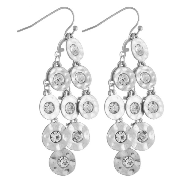 "Chandelier drop earrings featuring disc accents with rhinestone details. Approximately 2"" in length."