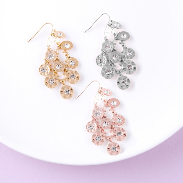 """Chandelier drop earrings featuring disc accents with rhinestone details. Approximately 2"""" in length."""