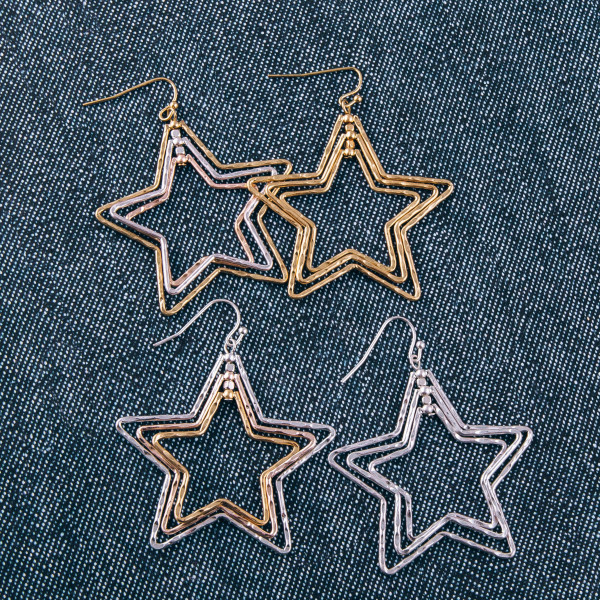 "Metal multi layered star earrings. Approximately 2"" in length."