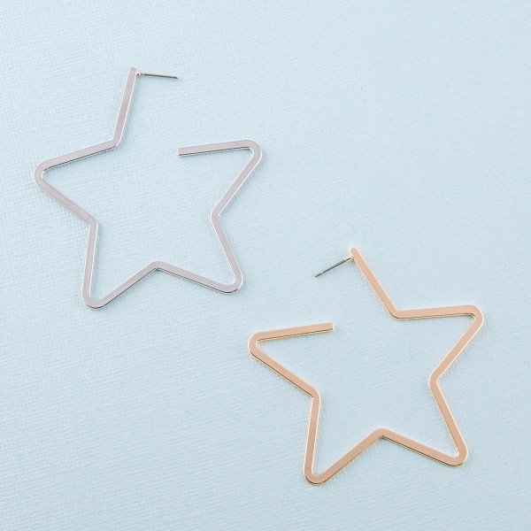 "Metal star open hoop earrings featuring a stud post. Approximately 2.5"" in length"