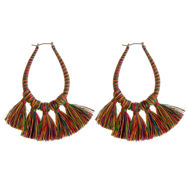 "Thread wrapped teardrop fan tassel pin catch hoop earrings. Approximately 3"" in length."