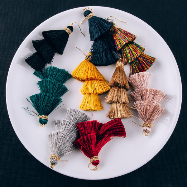"""Long fanned tassel earrings featuring a chain wrapped accent. Approximately 3"""" in length."""