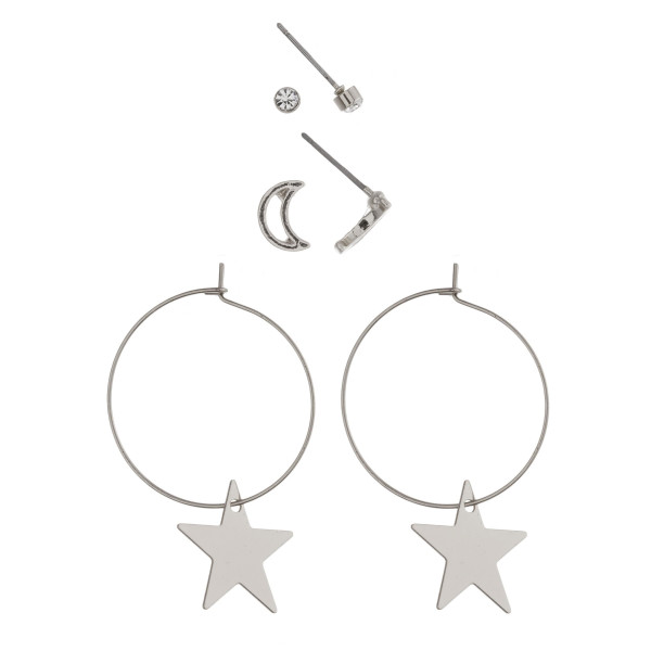 "Trio earring set featuring rhinestone and cut out moon stud details and dainty hoops with star accents. Studs approximately .5 cm each in size, hoops approximately 1.5"" in length."