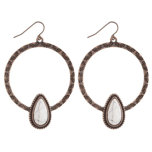 """Western style metal earrings featuring a natural stone teardrop accent. Approximately 2.5"""" in length."""