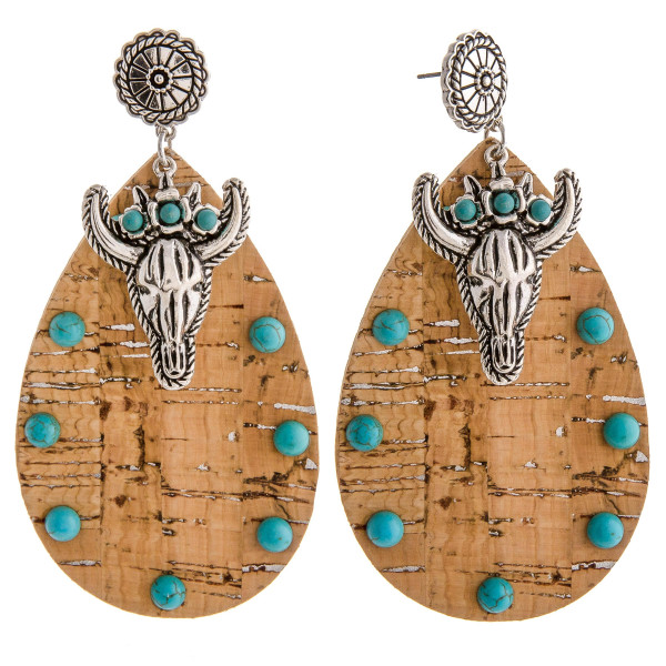 """Large cork inspired teardrop earrings featuring a metal cow skull detail with natural stone accents and a flower stud post. Approximately 3.5"""" in length."""