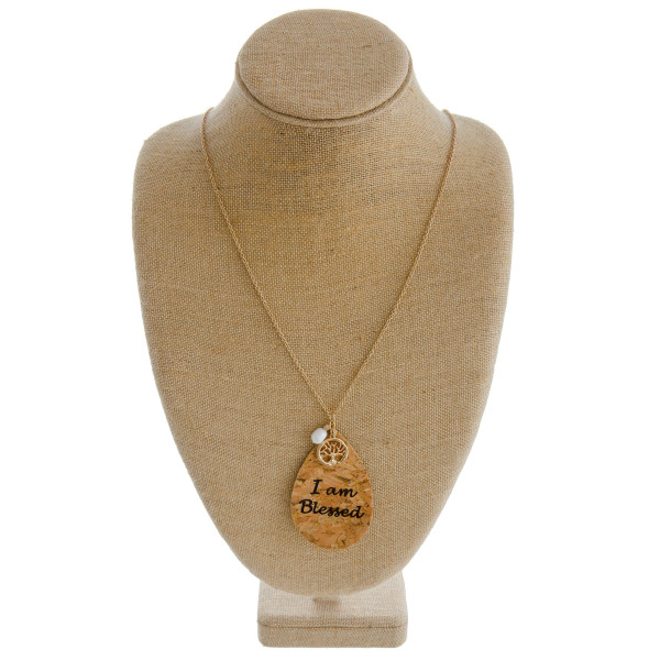 "Long cable chain necklace featuring a cork teardrop pendant with ""I Am Blessed"" inspiring message with a tree of life and pearl accent. Pendant approximately 3.5"". Approximately 38"" in length overall."