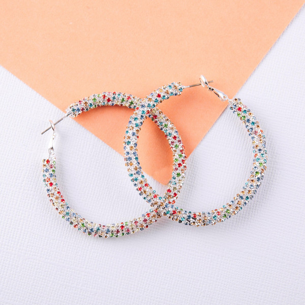 "Hoop earrings featuring multicolor cubic zirconia details. Approximately 2"" in diameter."