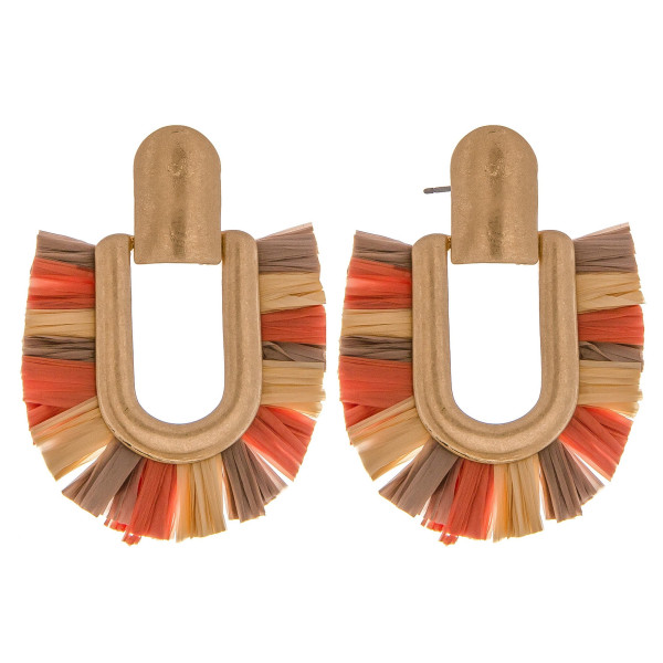 """Metal drop earrings featuring raffia tassel details and a stud post. Approximately 2"""" in length."""