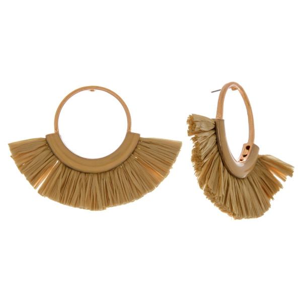 "Circular metal earrings featuring enamel and raffia tassel details with a stud post. Approximately 2"" in length."