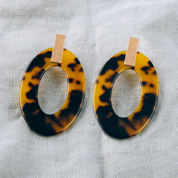 """Resin drop earrings featuring tortoise shell details and a gold metal stud accent. Approximately 2"""" in length."""