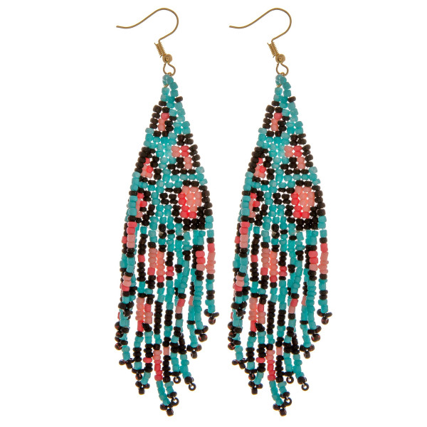"""Seed beaded tassel earrings featuring leopard print details. Approximately 3"""" in length."""