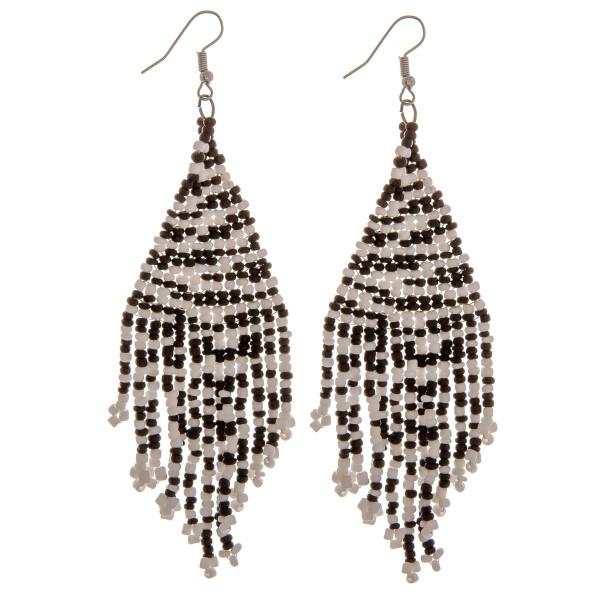 "Seed beaded tassel earrings. Approximately 3"" in length."