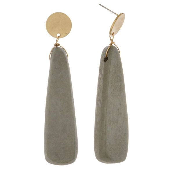 "Long wood inspired drop earrings featuring a metal stud post. Approximately 3"" in length."