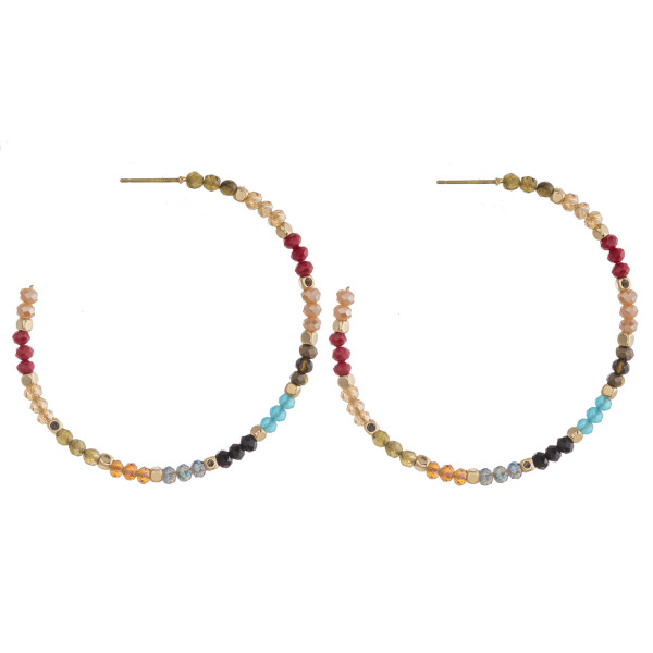 """Flexible wire hoop earrings featuring faceted beaded details and gold accents. Approximately 2"""" in diameter."""