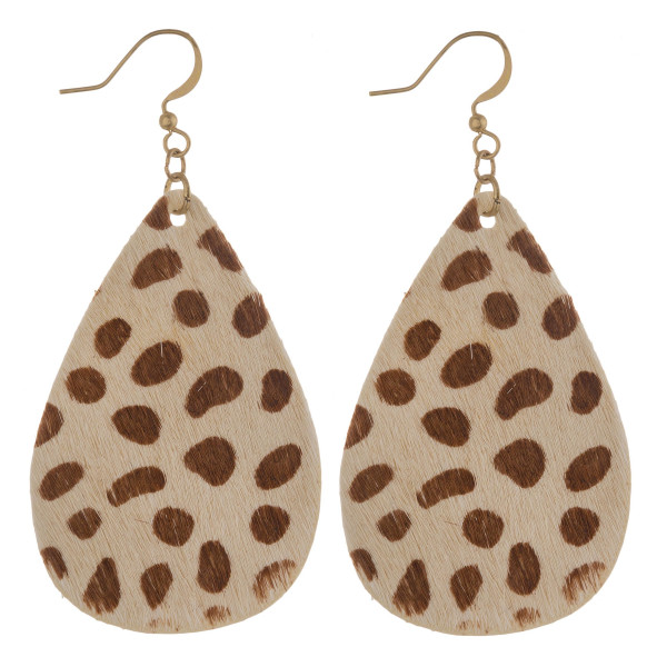 "Faux fur and genuine leather teardrop earrings featuring cheetah print details. Approximately 2.5"" in length."