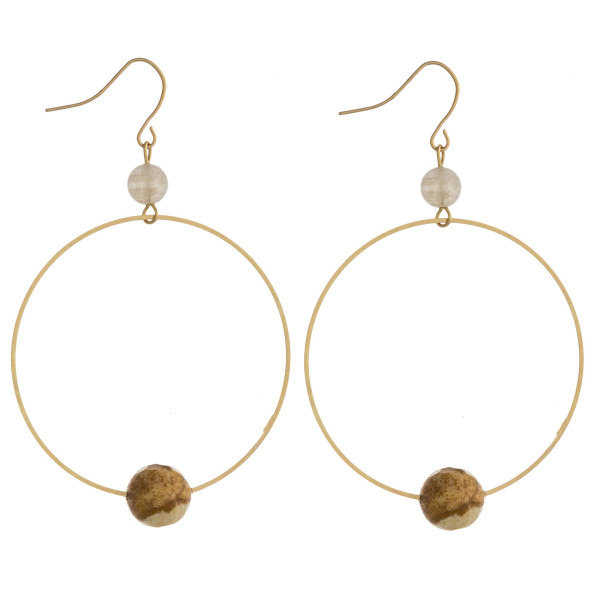 "Dainty circular drop earrings featuring natural stone accents. Approximately 2.5"" in length."