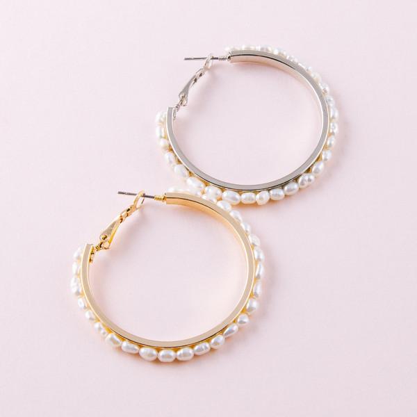"""Metal hoop earrings featuring pearl beaded details. Approximately 1.5"""" in diameter."""