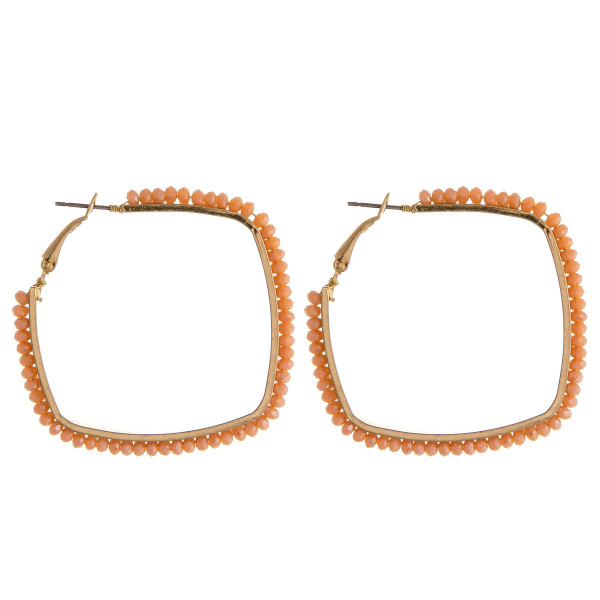 """Metal square hoop earrings featuring faceted beaded details. Approximately 2"""" in diameter."""