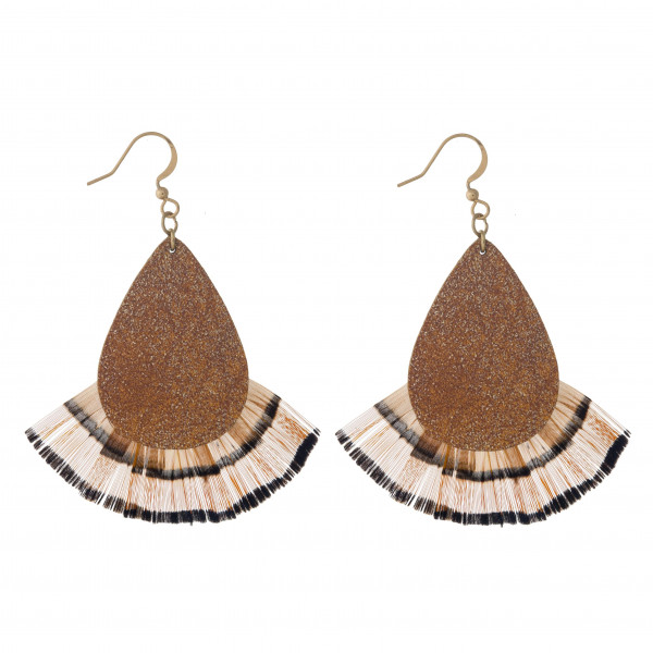 "Metallic faux leather teardrop earrings featuring feather inspired details. Approximately 2.5"" in length."