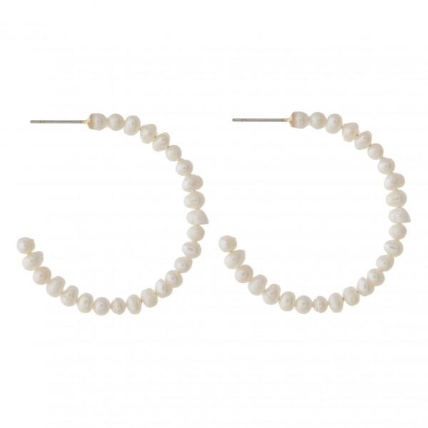 "Pearl beaded hoop earrings with a stud post. Approximately 1.5"" in diameter."