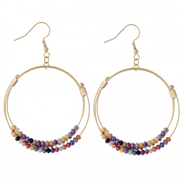 "Circular metal drop earrings featuring iridescent beaded details with multi stands and gold accents. Approximately 2.5"" in length."