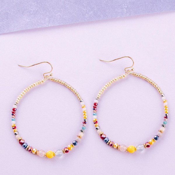 "Circular seed/faceted beaded earrings. Approximately 2"" in length."