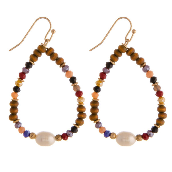 """Teardrop earrings featuring wood and faceted beaded details with a pearl accent. Approximately 2"""" in length."""