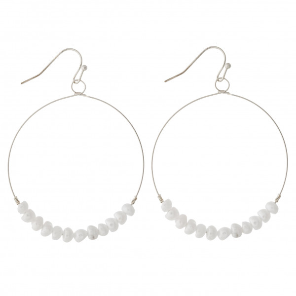 """Dainty circular earrings featuring pearl beaded details and wire wrapped accents. Approximately 2"""" in length."""