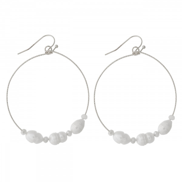 """Circular drop earrings featuring flexible wiring with pearl beaded details and iridescent bead accents. Approximately 2"""" in length."""