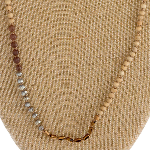 "Long beaded necklace with wood, iridescent, and block bead details. Approximately 34"" in length."