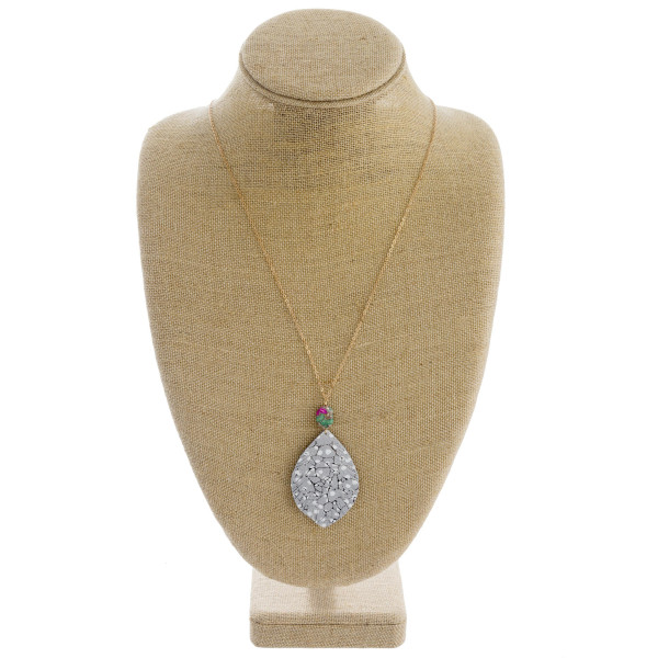 """Dainty cable chain necklace featuring a faux leather feather inspired pendant with metallic details and a natural stone accent. Pendant approximately 3"""". Approximately 34"""" in length overall."""