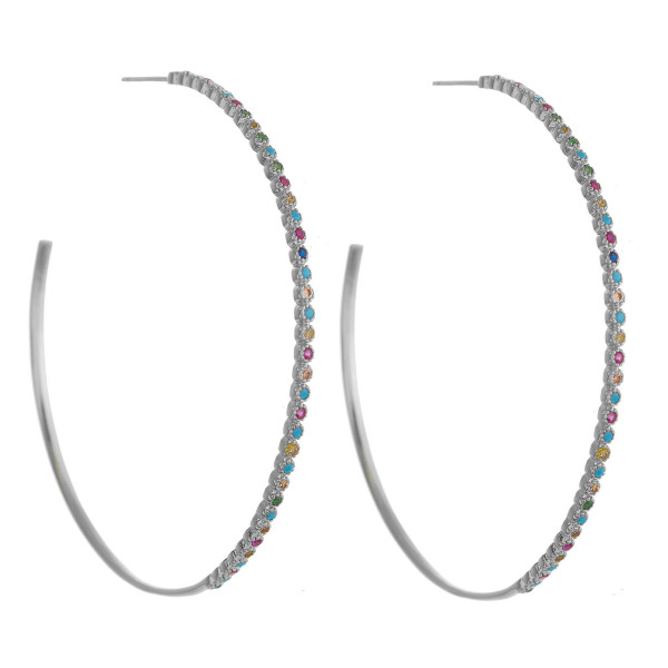 """Large dainty open hoop earrings featuring multicolor cubic zirconia details and a stud post. Approximately 2"""" in diameter."""